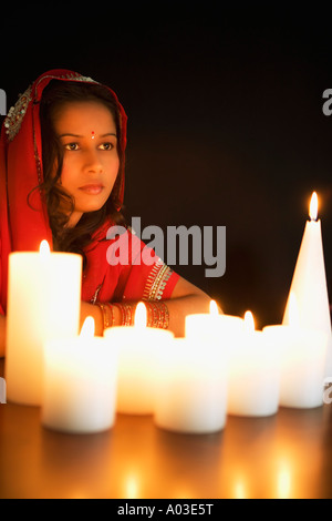 Woman by candle - Stock-Bilder