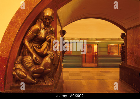 Russia former Soviet Union Moscow Red Square Metro Station statue of farmwife & chickens subway system - Stock Image
