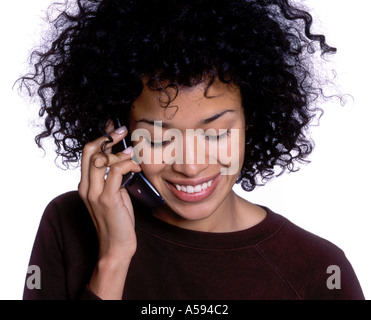 Young Woman With Curly Hair Talking on Phone - Stock Image