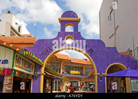Cozumel Mexico San Miguel town shopping plaza purple buildings - Stock Image