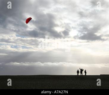 Kite flying on Brighton beach - Stock-Bilder