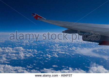Virgin Airlines aircraft wing in flight - Stock Image