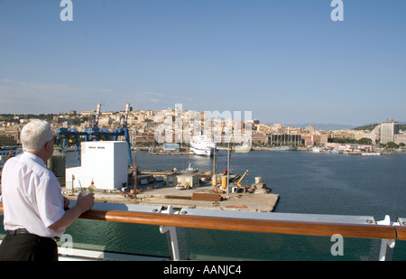 Cruse Ship Passenger, cocktail in hand, entering Cagliari, Sardinia, cocktail in hand drink cruiseship cruse ship - Stock Image