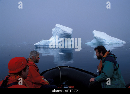 ANTARCTICA Paradise Bay with iceberg and heavy fog Tourists in Zodiac - Stock Image
