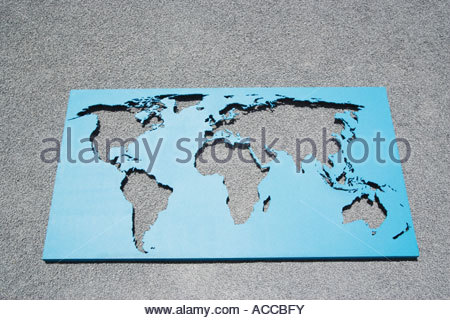 World map on gravel - Stock Image