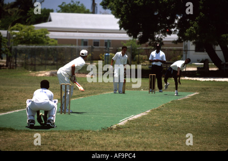 Grand Cayman BWI West Bay young Black male cricket players - Stock Image