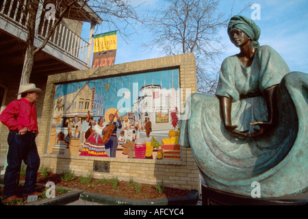 Texas The Southwest San Antonio Market Square resident views Mexican style mural depicts1940s downtown TX003 - Stock Image