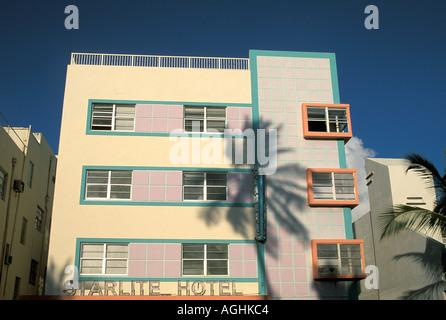 Miami Florida FL South Beach Classic Art Deco Architecture Ocean Drive coconut palm tree shadow on Starlite Hotel - Stock Image