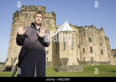 England UK Alnwick Castle 11th century Norman architecture Harry Potter movie site 1798 soldier guide - Stock Image