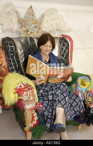 England UK Newcastle upon Tyne Lime Street Seven Stories children's book museum storyteller reading large chair - Stock Image