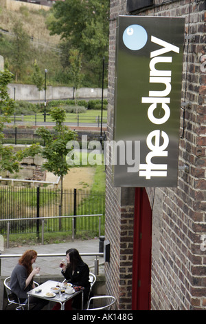 England UK Newcastle upon Tyne Lime Street Village Green The Cluny restaurant alfresco dining table - Stock Image