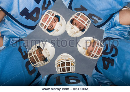American football players in huddle - Stock Image