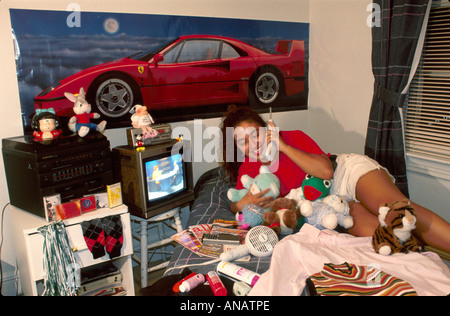 New Jersey Passaic Hispanic female teen bedroom telephone poster car Ferrari television stereo stuffed animals - Stock Image