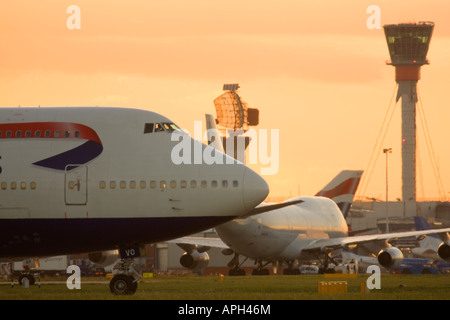 Commercial airliners and new air traffic control tower at London Heathrow Airport England UK - Stock Image