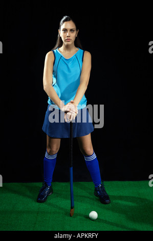 Feminine hockey player - Stock Image