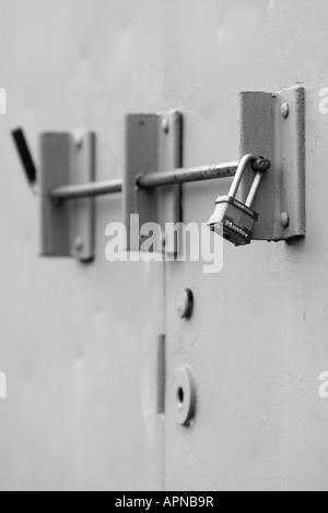 A locked steel door with padlock - Stock Image & Padlocked Door Black and White Stock Photos \u0026 Images - Alamy Pezcame.Com