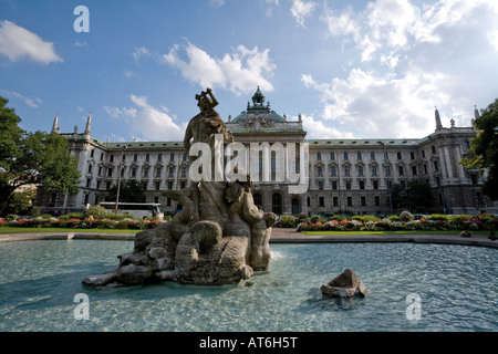 Germany, Bavaria, Munich, Fountain in front of District Court - Stock Image