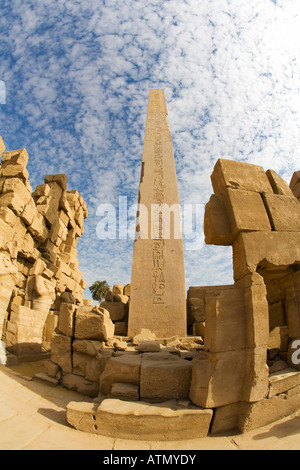 Temple of Amun Re Amun-Re with sun on obelisk erected by Queen Hatshepsut Karnak Temple Thebes Luxor Egypt North - Stock Image