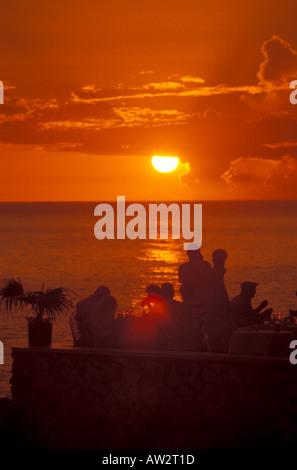 Jamaica Negril Sunset at Ricks Cafe orange sky - Stock Image