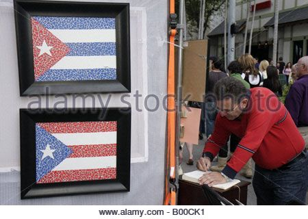 Coral Gables Cuban Puerto Rico flag art nationalism painting framed man gallery owner - Stock Image