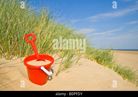 A concept image of a 'bucket and spade' beach holiday. - Stock-Bilder