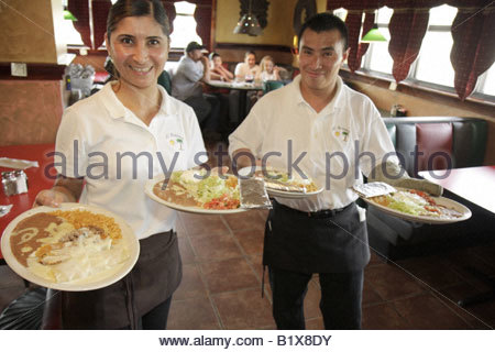 Arkansas Pocahontas El Acapulco Authentic Mexican Cuisine restaurant Hispanic woman man waitress waiter plates food - Stock Image