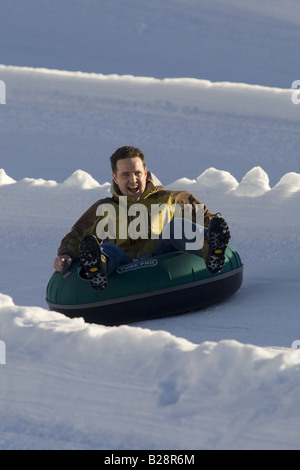 man enjoying a tube ride Whistler British Columbia Canada - Stock Image