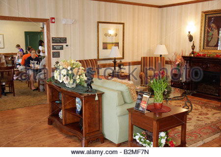 Indiana Valparaiso Country Inn and Suites lobby breakfast room lodging motel guests furniture - Stock Image