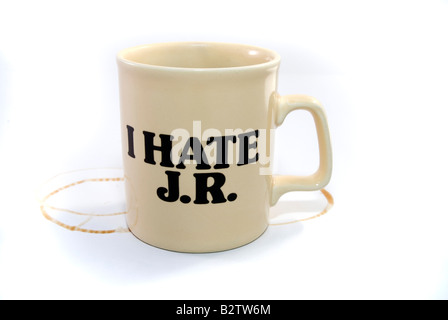 A cup of coffee with ring marks and the 'I HATE JR' slogan. JR - the fictional evil boss character from - Stock Image