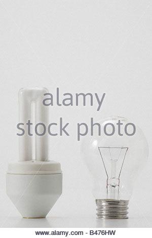 An ordinary and energy saving lightbulb - Stock Image