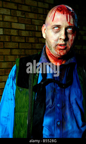 Portrait of man dressed as a zombie - Stock Image