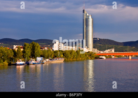 Vienna's Millenium Tower and Brigittenauer Bridge on Danube River in early morning light - Stock Image