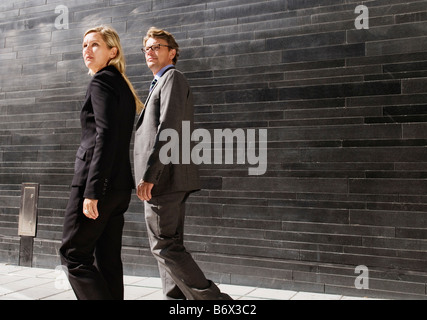 Man and woman on the go - Stock-Bilder