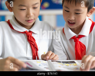 Two Chinese school boys studying together. - Stock Image