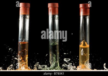 Three test tubes breaking on impact - Stock Image