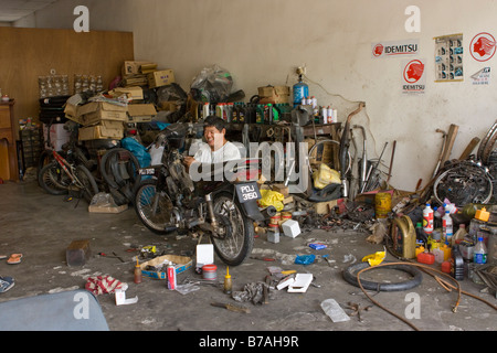 Motor cycle workshop stock photos motor cycle workshop for Motorized bicycle repair shop