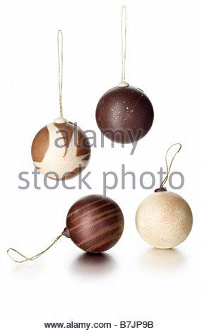 chocolate ball xmas tree decorations - Stock Image