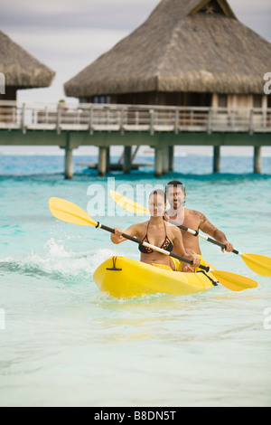 Couple in canoe in bora bora - Stock Image