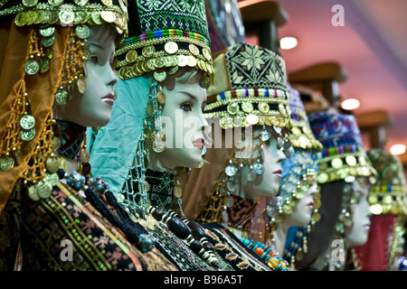 Close up of  heads of mannequins, wearing traditional Arabic and Jordanian costume. Taken in downtown Amman market - Stock Image