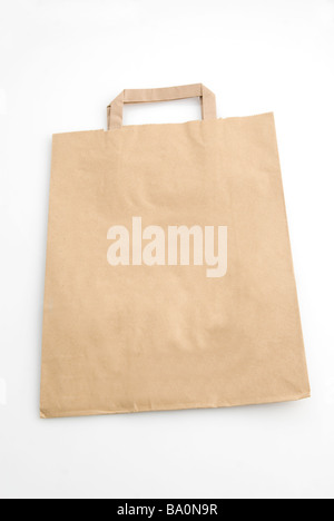 Brown paper bag isolated against a white background - Stock Image