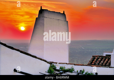 Sundown and typical chimney at the historical village of Monsaraz - Stock Image