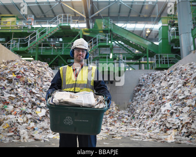 Worker With Waste Recycling Box - Stock Image