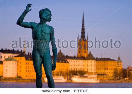 Statue at Stadshuset (City Hall), with Riddarholmen in the background, Stockholm, Sweden. - Stock Image