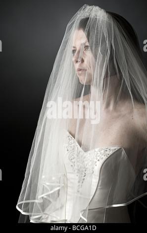 Low Key Shot of an Upset Bride - Stock Image