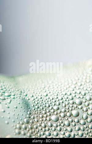 Water droplets on surface, close-up - Stock Image