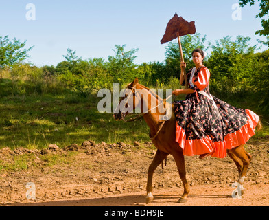 a girl participant in the annual festival of 'Patria Gaucha' in Tacuarembo , Uruguay - Stock Image