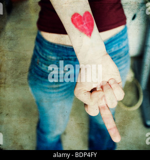 close-up of a woman's hand with a heart on her wrist - Stock Image