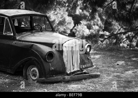 old black car left to rest in nature on the island of samos, greece - Stock Image