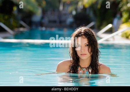 Portrait of a young woman in a swimming pool - Stock-Bilder