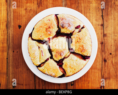 Austrian Bread Dumpling With Fruit On Rustic Wooden Table - Stock Image